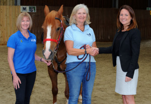 Bellway South London Job: Bellway South London have donated £625 to the Riding School for the disabled Pictured: Natalie Hughes (black top) Bellway South London Sales Manager). Liz Harrison (Grey hair light blue top) Cranleigh RDA Chair and Paula Jones (Darker Blue) Surrey County Chair Horse was called. Sunny Pictures Ian Scammell